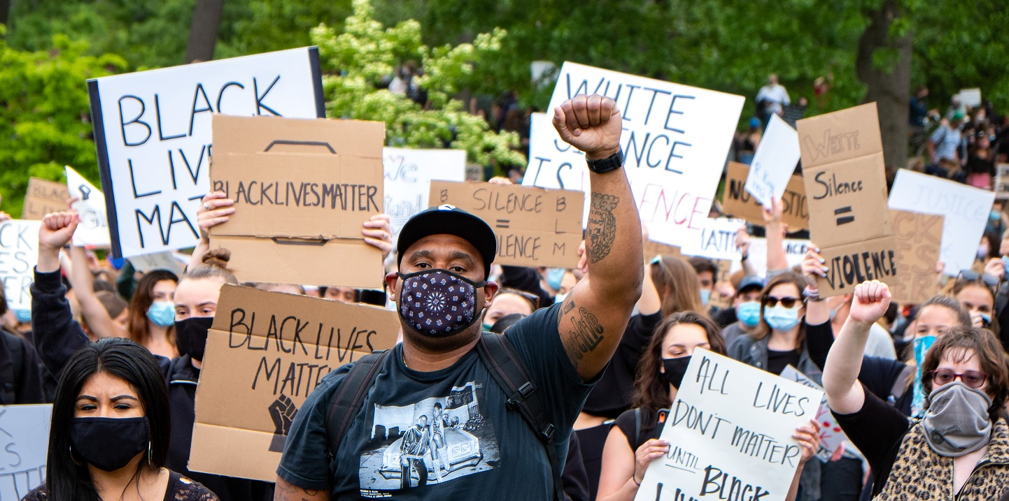 Black protesters in a march photo 1440 x 720.'