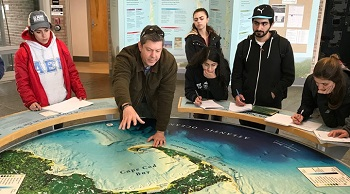 Dean of Arts and Sciences Rich Oches with students on Cape Cod
