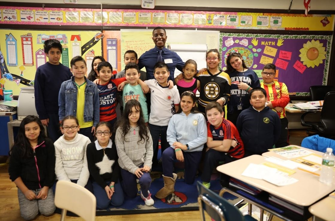 Brandon Samba with kids at the James Otis Elementary School in East Boston
