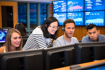 Students with professor in the Trading Room