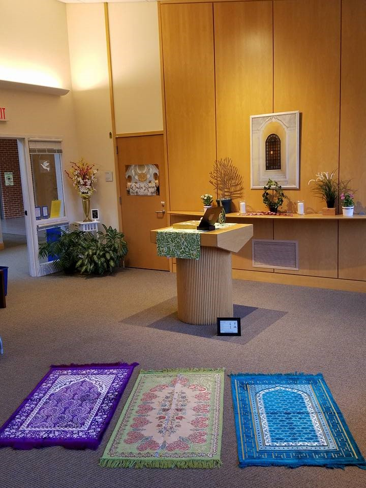 Three prayer rugs are arranged in the Sacred Space.