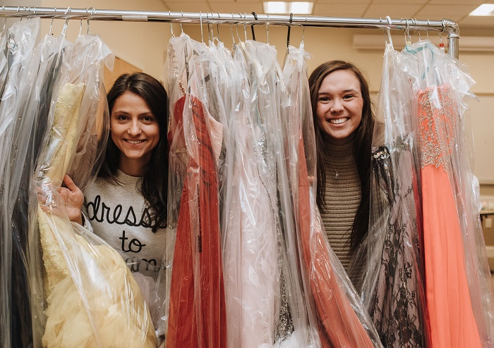 Students at Bentley University's Dresses to Dreams event