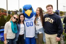 undergraduate students at bentley football game