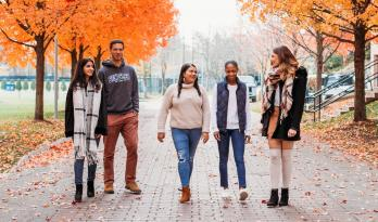 Students stroll together on Bentley campus