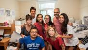 Families in dorm at Bentley University for move-in day